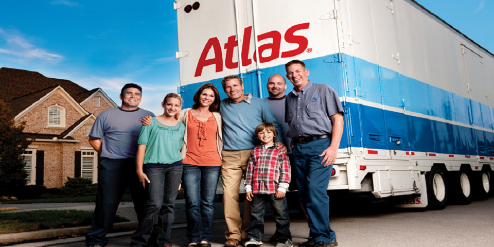 Family standing in front of Atlas Truck
