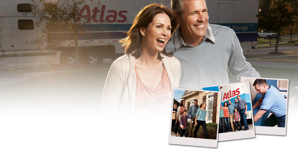 Happy couple moving with atlas truck